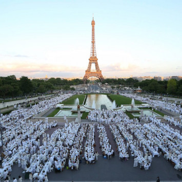 Parisians celebrate the 25th anniversary of Le Dîner en Blanc in 2013, in front of the Eiffel Tower.